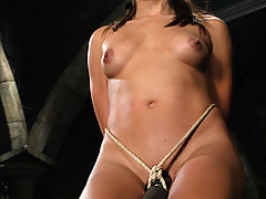 Water Bondage Pictures -  Bound in net Keeani Lei has some wet sexy fun
