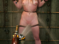 Water Bondage Pictures -  Madison finds herself tied to bars and doused in a jail cell