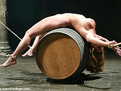 Water Bondage Pictures -  Bound over barrels Christina Carter makes every man hard