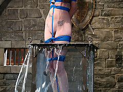 Water Bondage Pictures -  Swiss miss finds herself in an uncomfortable suspension