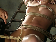 Bondage Pictures -  Hollie Stevens eats the ground in this Waterbondage shoot