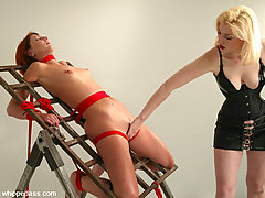 Lesbian Pictures -  Cowgirl doms Ivy, tied to steel rack, caned, vibrator play.