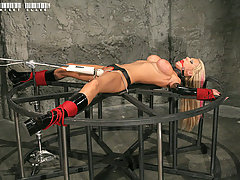 Slaves Pictures -  Big tit Tanya tied to the wheel and cumming