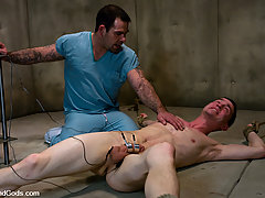 Gay Pictures -  Dak Ramsey fucks CJ while suspended in the padded cell.