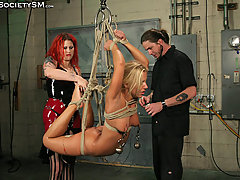 BDSM Pictures -  New to America, this Hungarian is welcomed the bondage way!