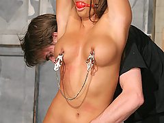 Slaves Pictures -  Hot model tied and cumming!