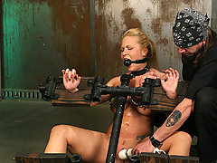 Pain Pictures -  Busty maiden restrained in pain!