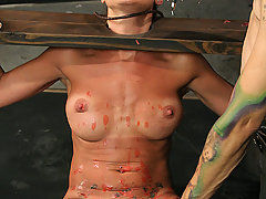 Pain Pictures -  Hot MILF in pain bondage!