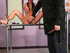 Extreme Pictures -  Busty Asian bondage slave!