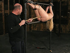 Extreme Pictures -  Blonde in extreme bondage!