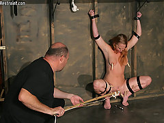 Torture Pictures -  Vicky is restrained on all fours