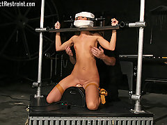 BDSM Pictures -  Jennifer is chained by Big Bad.