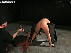 Pain Pictures -  Restrained in her chair, Luscious awaits her fate in the dark dungeon.