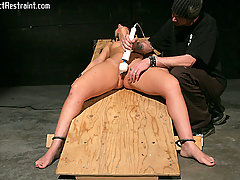 Extreme Pictures -  Restrained in her chair, Luscious awaits her fate in the dark dungeon.