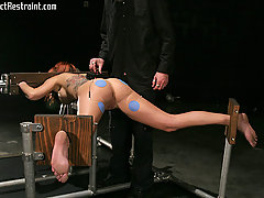 Pain Pictures -  Tricia is gagged and restrained in the cold darkness.