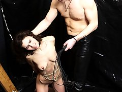 Punishment Pictures -  Chained slave gets whipped then sucks master's cock before fucking