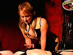 Torture Pictures -  Blond mistress in rubber dress snipping lingerie on a bound and gagged cutie