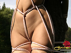 Outdoors Pictures -  Lesbian rope bondage training and domination in the deep woods
