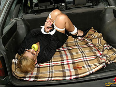 Bondage Pictures -  Tied and gagged secretary in the luggage boot