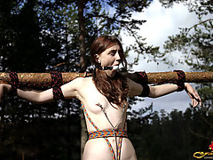 Outdoors Pictures -  Girl being punished with a rope bondage outdoors