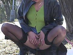 Watersports Pictures -  Horny redhead in stockings caught peeing in the park