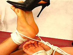 Domination Pictures -  Mistress gives bondage session to male sub