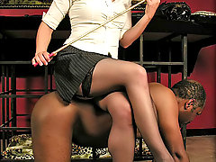 Femdom Pictures -  Young dominant lady plays with her ebony slave making him to serve her
