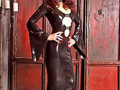 Femdom Pictures -  Gorgeous mistress in long latex dress trains two sissy slaves in her dungeon