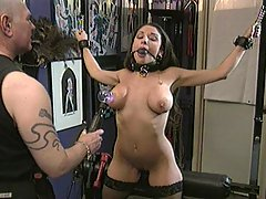 Femdom Pictures -  Perverted master has his sexy slave cuffed, then punishes her with bulb, clamps & flogger