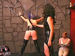 Femdom Pictures -  Mistress in latex dress roping a slave girl in bondage preparing her for training