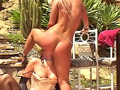 Femdom Pictures -  Hot busty lesbian blondes fucking with strapon dildo outdoors