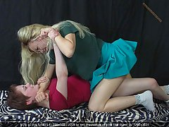 Wrestling Pictures -  Women in bed grapple and struggle against each other