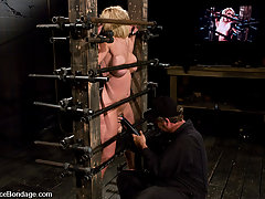 BDSM Toys Pictures -  Big titted blond trapped in metal bondage made to cum!!!!