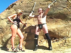 Femdom Pictures -  Shayne Ryder chains her slave outside and abuses his cock