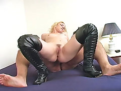 Torture Pictures -  Blond Mistress Melanie dishes out punishment with her black thigh high boots