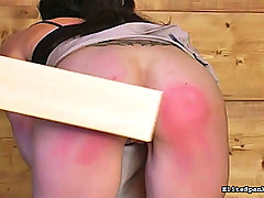 Spanking Pictures -  Girl with tats gets spanked