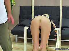 Spanking Pictures -  Short blond slut gets strapped down and paddled