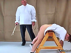 Spanking Pictures -  Girl in white dress gets caned again!