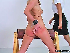 Spanking Pictures -  Hot red head gets her ass paddled