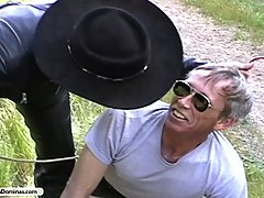 Torture Pictures -  Cowgirl whips bandit tied to tree