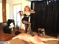 Punishment Pictures -  Hot blonde in stockings binds and whips dirty old man