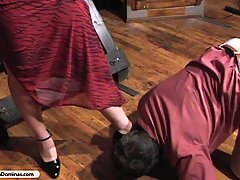 Domination Pictures -  Brunette in evening gown beats man for information