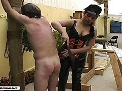 Femdom Pictures -  Hot Bitch claws his chest and whips him hard