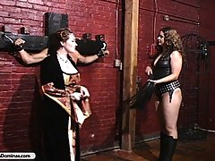 Domination Pictures -  Two cruel bitches torture captured spy in their dungeon