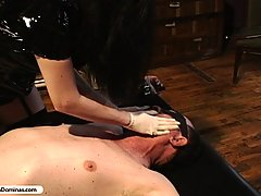 Domination Pictures -  Kinky Slut in black PVC abuses his cock